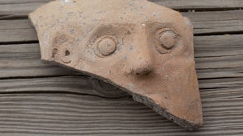 Ancient clay jar fragment depicting 'grotesque' deity discovered in Jerusalem's City of David