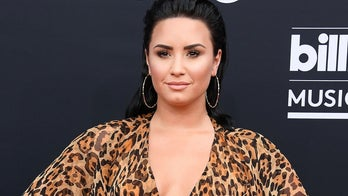 Demi Lovato shares post claiming gender reveals contribute to transphobia, draws mixed reactions