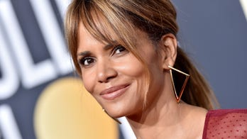 Halle Berry, wearing plunging leather romper, shows off edgy buzz cut at movie premiere