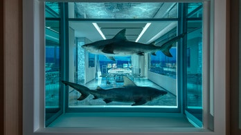 World's most expensive hotel room at Palms Casino features formaldehyde-suspended sharks, 24-hour butler service