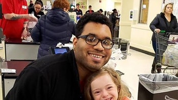 Mom thanks grocery cashier for special moment with young daughter in viral video