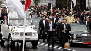 Man rushes car carrying Moroccan king during motorcade with Pope Francis