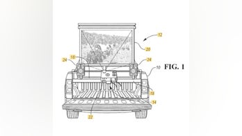 Drive-in theater? Ford patents pickup bed movie screen system