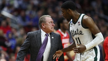 Michigan State coach Tom Izzo restrained while berating freshman player Aaron Henry