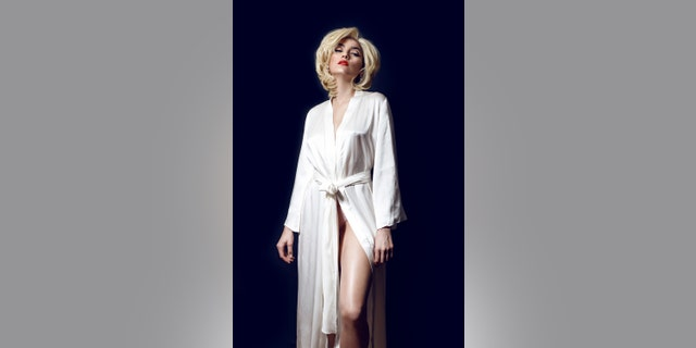 Actress Blanco pays tribute to Marilyn Monroe. Hair and makeup by Mina Abramovic. The $750 white robe is by Los Angeles designer Limerence.