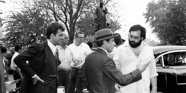 """On the set of """"The Godfather,"""" baptism day, (L to R) Gianni Russo, Al Pacino and director Francis Ford Coppola."""