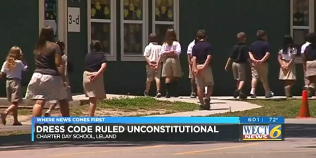 Students play outside Charter Day . The school's dress code was unconstitutional