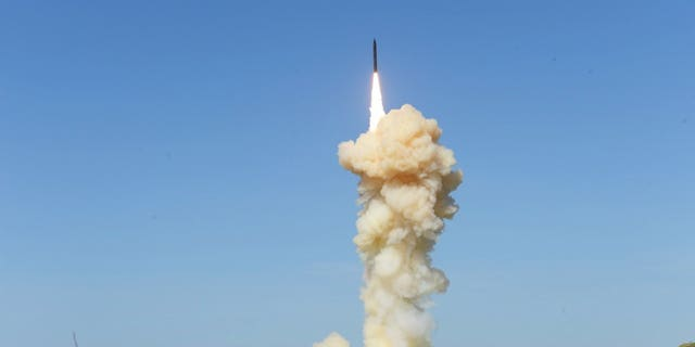 """In this photo provided by the Missile Defense Agency, the lead ground-based Interceptor is launched from Vandenberg Air Force Base, Calif., in a """"salvo"""" engagement test of an unarmed missile target Monday, March 25, 2019."""