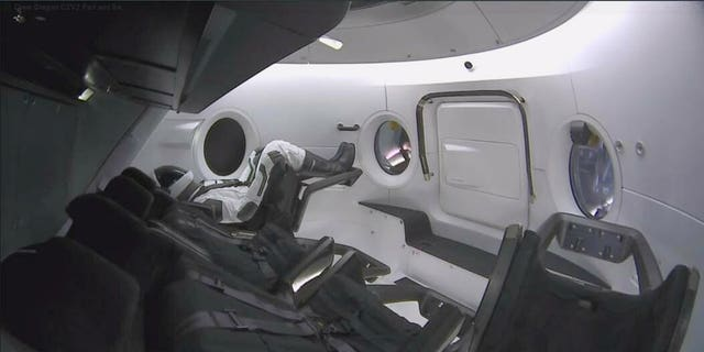 This photo provided by SpaceX shows a test dummy in the new Dragon capsule designed for astronauts. (SpaceX via AP)
