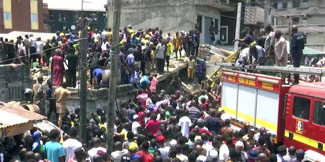 Rescue workers and emergency teams at the scene of the building collapse in Lagos, Nigeria.