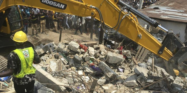 Emergency services at the scene after a school building collapsed in Lagos, Nigeria, on Wednesday.