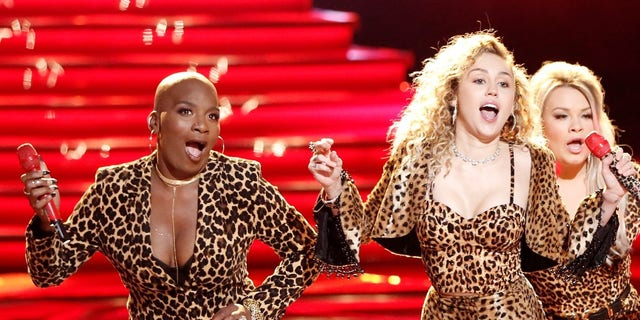 "Janice Freeman, left, performs with Miley Cyrus on ""The Voice."""