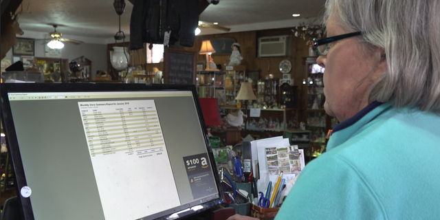 """Local business owners in the neighboring towns of Lordstown, Ohio are feeling the impact of the recent closure of the General Motor's plant. Kathleen """"KC"""" Watson reviews her January sales, the lowest on record since she opened three years ago."""