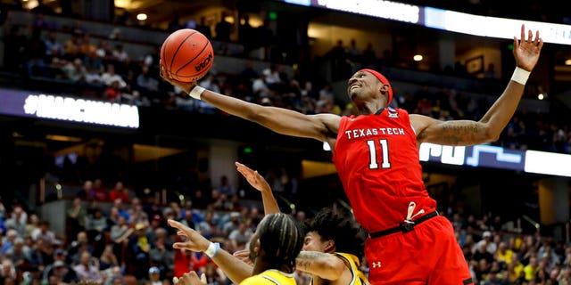 Texas Tech forward Tariq Owens (11) shoots over Michigan defenders during the second half an NCAA men's college basketball tournament West Region semifinal. (Associated Press)