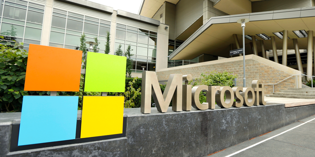FILE - This July 3, 2014 file photo shows Microsoft Corp. signage outside the Microsoft Visitor Center in Redmond, Wash.