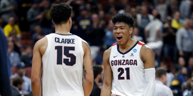 Gonzaga forward Rui Hachimura, right, and forward Brandon Clarke celebrate the team's win against Florida State during an NCAA men's college basketball tournament West Region semifinal. (Associated Press)