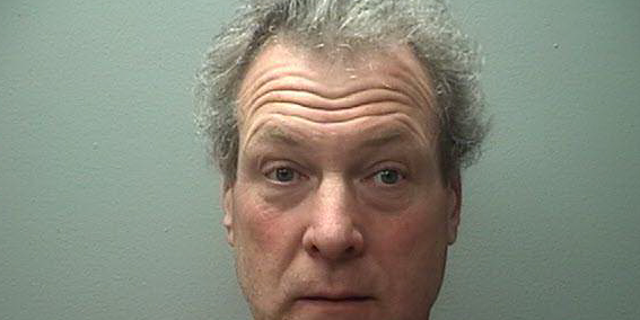 """Robert Wild, 56, was taken into custody after he allegedly admitted to """"discarding the puppies,"""" police said."""