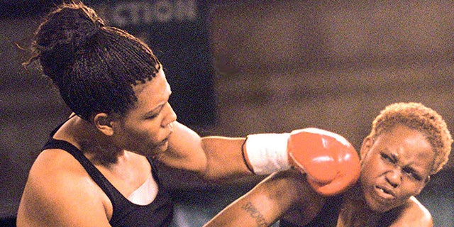Freeda Foreman, left, daughter of former boxing champion George Foreman, lands a left to the head of LaQuanda Landers, right, in the first round of their pro debuts at the Regent Resort in Las Vegas, June 18, 2000. (John Gurzinski/AFP/Getty Images)