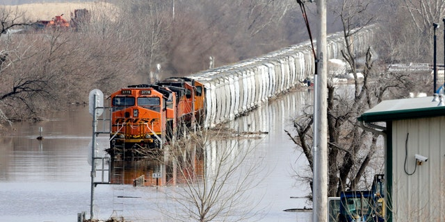 A BNSF sight sits in inundate waters from a Platte River, in Plattsmouth, Neb., Sunday, Mar 17, 2019. (AP Photo/Nati Harnik)