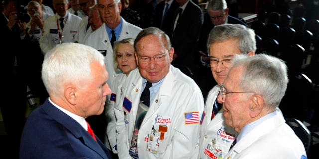 Vice President Mike Pence, left, speaking with museum docents at the National Space Council meeting held at the U.S. Space and Rocket Center. (Associated Press)