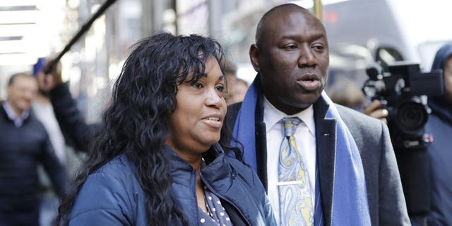 """Tamara Lanier, left, and attorney Benjamin Crump, right arrive for a news conference near the Harvard Club Wednesday, March 20, 2019, in New York. Lanier, of Norwich, Conn., is suing the Harvard University for """"wrongful seizure, possession and expropriation"""" of images she says depict two of her ancestors."""