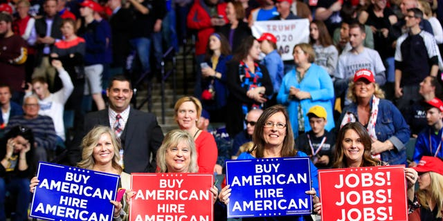 People waiting for President Donald Trump to speak at the rally in Grand Rapids, Mich., on Thursday. (AP Photo/Manuel Balce Ceneta)