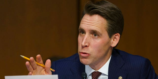 FILE - IN this Jan 15, 2019 file photo, Senate Judiciary Committee committee member Sen. Josh Hawley, R-Mo., questions Attorney General nominee William Barr during a Senate Judiciary Committee on Capitol Hill in Washington. (AP Photo/Carolyn Kaster, File)