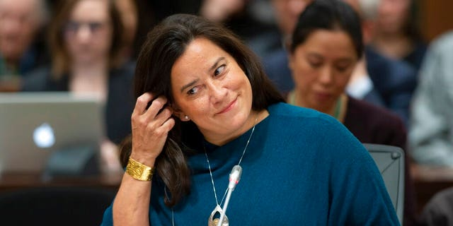 Jody Wilson Raybould adjusts her earpiece as she waits to appear in front of the Justice committee in Ottawa, Wednesday February 27, 2019. 7, 2019.