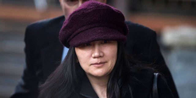 Huawei chief financial officer Meng Wanzhou leaves her home to attend a court appearance in Vancouver, British Columbia.