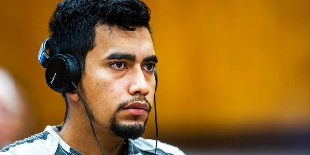 Cristhian Bahena Rivera wears headphones during his arraignment where he pleaded not guilty to the charge of first-degree murder in the death of Mollie Tibbetts at the Poweshiek County Courthouse in Montezuma, Iowa.