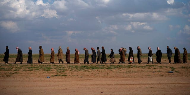 On this Friday, February 22, the movie scene goes men screened after being evacuated out of the last territory held by Islamic state militants, near Baghouz, eastern Syria