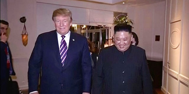 In this image made from video released on Wednesday, March 6, 2019, by North Korean broadcaster KRT, North Korean leader Kim Jong Un, right, smiles while walking with U.S. President Donald Trump for a meeting in Hanoi, Vietnam.