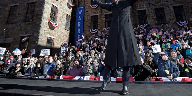 Sen. Elizabeth Warren, D-Mass., acknowledges cheers as she takes the stage during an event to formally launch her presidential campaign in Lawrence, Mass.