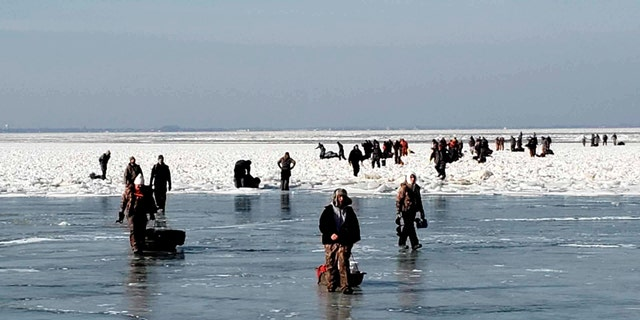 """Some of the ice fishermen made it back to shore """"by swimming or walking on ice-bridges,"""" the Coast Guard confirmed."""