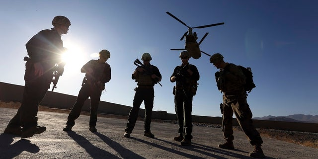 FILE - In this Nov. 30, 2017 file photo, American soldiers wait on the tarmac in Logar province, Afghanistan. Two members were killed Friday during an operation in the country. (Associated Press)