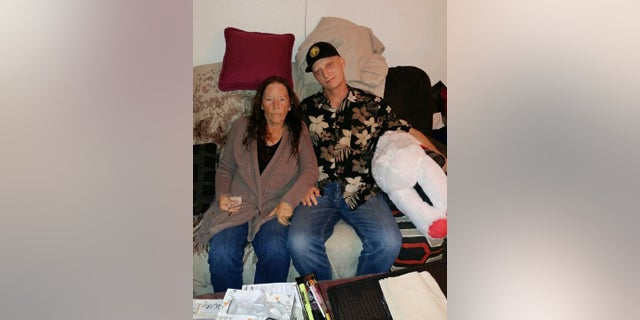 White is seen with his mother, Joanne White, in a photo released by his laywer Mark Zaid. (White family via AP)