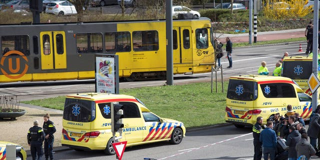 Ambulances are seen next to a tram after a shooting in Utrecht, Netherlands, Monday.