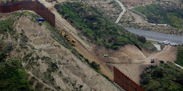 At least 25,000 people reportedly cross the border legally between Tijuana and San Ysidro on foot every day