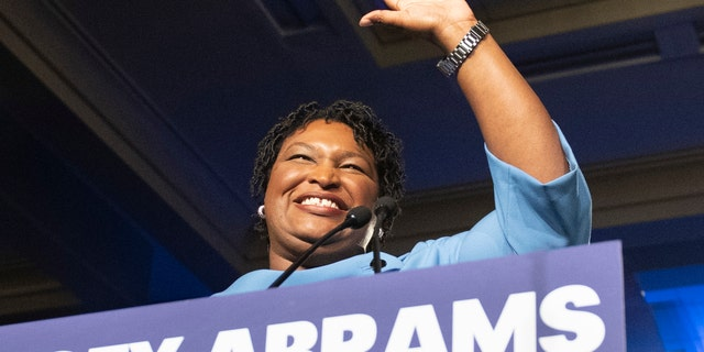 In this Nov. 6, 2018 file photo, former Georgia Democratic gubernatorial candidate Stacey Abrams speaks to supporters in Atlanta. (AP Photo/John Amis)