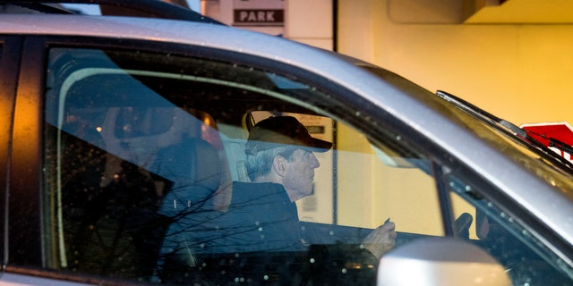 Special Counsel Robert Mueller arrives at his office building, Thursday, March 21, 2019, in Washington. Mueller has concluded his investigation into Russian election interference and possible coordination with associates of President Donald Trump. (AP Photo/Andrew Harnik)