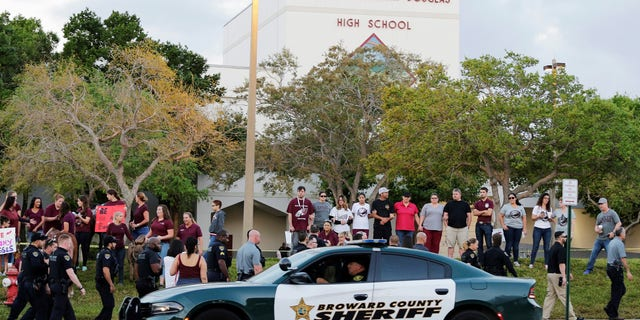 A student who survived the Parkland school shooting died of an apparent suicide on Saturday, police said.