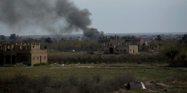 Smoke rises from a strike on Baghouz, Syria, on the Islamic State group's last piece of territory on Friday, March 22, 2019. (AP Photo/Maya Alleruzzo)