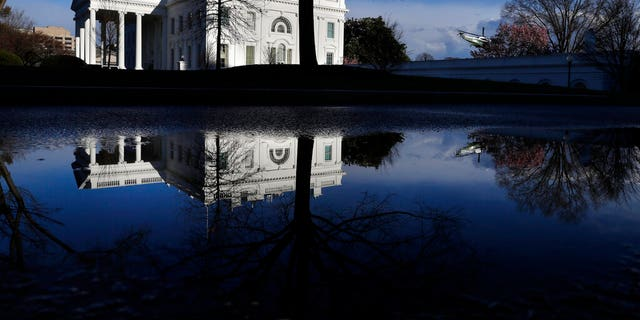 A presidential helicopter takes off in a practice run as the White House is reflected in a puddle, Friday March 22, 2019, in Washington, amid news that special counsel Robert Mueller has concluded his investigation into Russian election interference and possible coordination with associates of President Donald Trump.