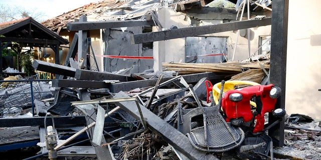 A house lies in ruins after being hit by a rocket in Mishmeret, central Israel, Monday, March 25, 2019. An early morning rocket from the Gaza Strip struck a house in central Israel on Monday, wounding six people, including one moderately, an Israeli rescue service said, in an eruption of violence that could set off another round of violence shortly before the Israeli election. (AP Photo/Ariel Schalit)