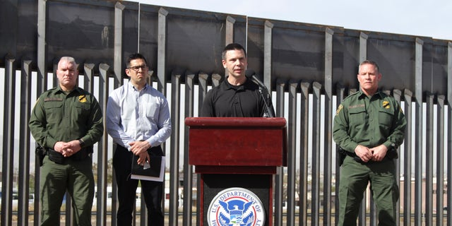 Customs and Border Protection Commissioner Kevin McAleenan, center, announced that the Trump administration will temporarily reassign several hundred border inspectors during a news conference at the border in El Paso, Texas on Wednesday. (AP Photo/Cedar Attanasio)