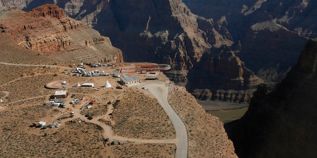 The Skywalk hangs over the Grand Canyon on the Hualapai Indian Reservation before its grand opening ceremony at Grand Canyon West, Ariz. Crews are searching for a tourist who slipped and fell over the edge of a Grand Canyon lookout on tribal land. (AP Photo/Ross D. Franklin, File)