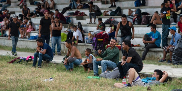 Central American migrants, part of the caravan hoping to reach the U.S. border, take a break in Acacoyagua, Chiapas State, Mexico, Thursday, March 28, 2019. A caravan of about 2,500 Central Americans and Cubans is currently making its way through Mexico's southern state of Chiapas. (AP Photo/Isabel Mateos)