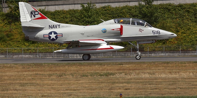 Seattle, Wa, United States - July 17, 2016: The TA-4J, a 2-seater version of the A4 Skyhawk light navy jet fighter was seen flying over Seattle for Boeing's centennial celebrations.