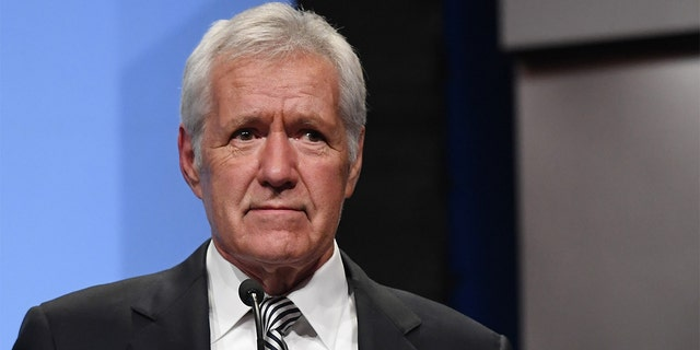 """Jeopardy!"" host Alex Trebek speaks as he is inducted into the National Association of Broadcasters Broadcasting Hall of Fame at the Encore Las Vegas on April 9, 2018, in Las Vegas."