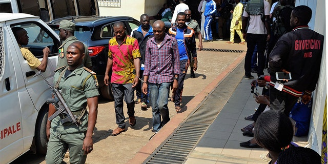 Men arrested in connection with Cameroon's anglophone crisis are seen at the military court in Yaounde, Cameroon, on December 14, 2018. - Nearly 300 people who were arrested in connection with Cameroon's anglophone crisis will be released on Friday, a day after being pardoned by President Paul Biya, the defense minister said.